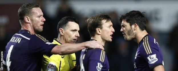 West ham team-mates James Tomkins (far right) and Mark Noble were involved in a disagreement late on