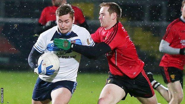 Caolan Mooney of Ulster University battles with Down's Peter Fitzpatrick