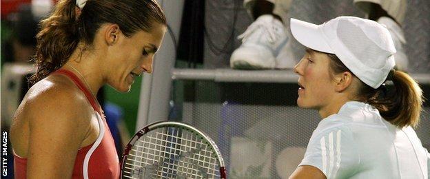 Amelie Mauresmo consoles Justine Henin after the Belgian's retirement from the Australian Open final in 2006