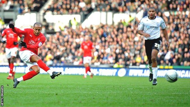 Robert Earnshaw scores for Forest against Derby at Pride Park in 2011