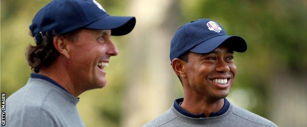 Tiger Woods and Phil Mickelson of the USA share a joke during the second preview day of The 39th Ryder Cup at Medinah Country Golf Club on September 25, 2012 in Medinah.