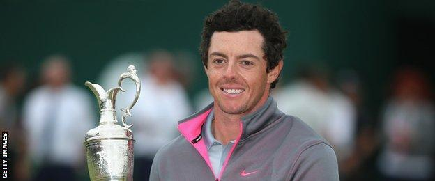 Rory McIlroy of Northern Ireland holds the Claret Jug after his two-stroke victory at The 143rd Open Championship at Royal Liverpool on July 20, 2014 in Hoylake, England.