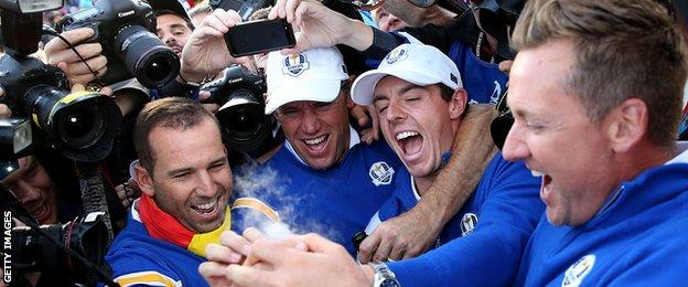 Sergio Garcia, Lee Westwood, Rory McIlroy and Ian Poulter of Europe celebrate winning the Ryder Cup after the Singles Matches of the 2014 Ryder Cup