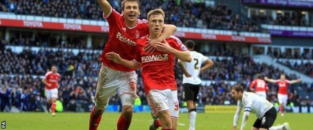 Ben Osborn (right) celebrates his late winner against Derby at the iPro Stadium