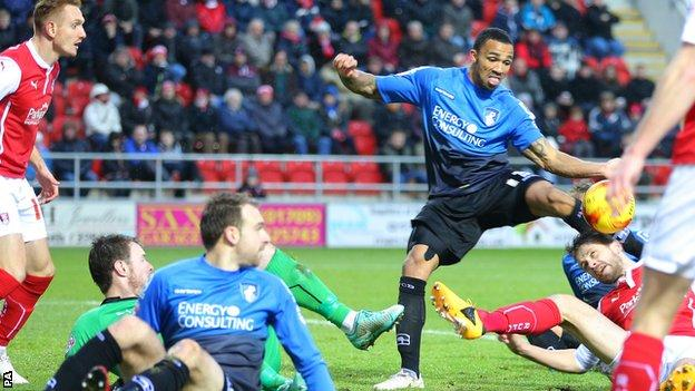 Callum Wilson hooks home Bournemouth's second goal against Rotherham