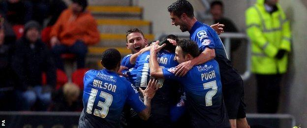 Bournemouth players rush to congratulate Tommy Elphick as he celebrates scoring the first goal