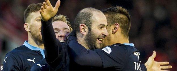 Gary Harkins celebrates scoring Dundee's third goal