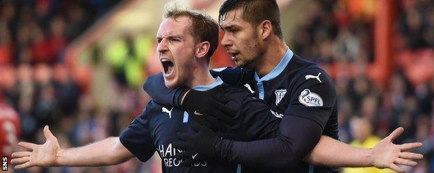 Gary Irvine (left) celebrates his equaliser for Dundee