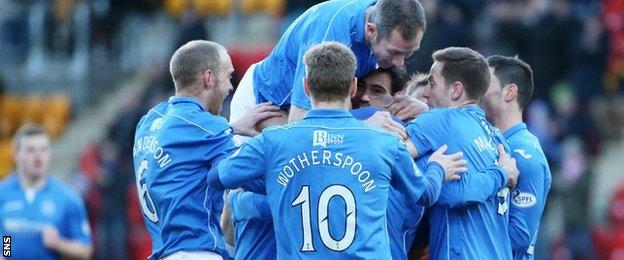 Dave Mackay (centre) is mobbed by his teammates after giving St Johnstone the lead