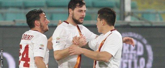 Roma's Mattia Destro is congratulated by his team-mates