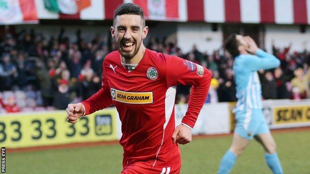 Joe Gormley's goal put Cliftonville ahead but Mark Hughes replied to earn Warrenpoint Town a point