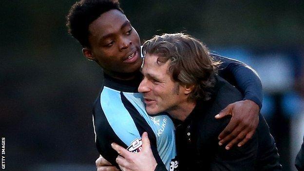 Fred Onyedinma (l) hugs Wycombe Wanderes boss Gareth Ainswoth