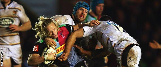 Harlequins centre Matt Hooper is tackled by James Haskell and Alapati Leuia of Wasps