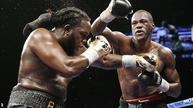 Deontay Wilder (right) on the way to beating Bermane Stiverne