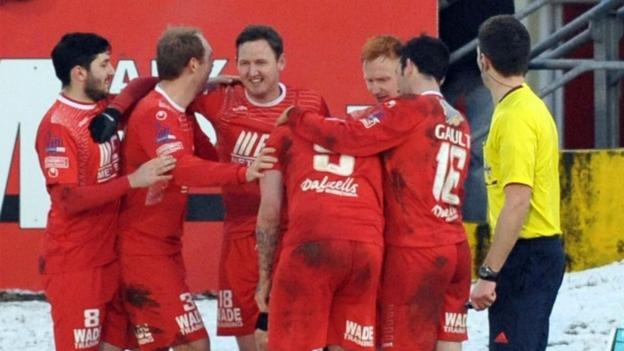 Gary Twigg is congratulated by Portadown team-mates after scoring one of his three goals in the dramatic 5-5 draw against Ballymena