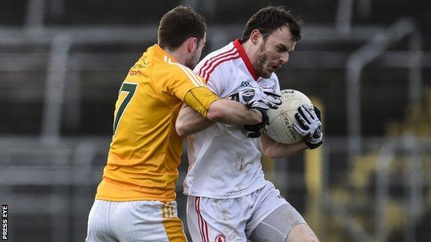 Emmet Killough and Barry Tierney in action at Clones