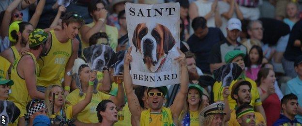Supporters cheer for Australia's Bernard Tomic