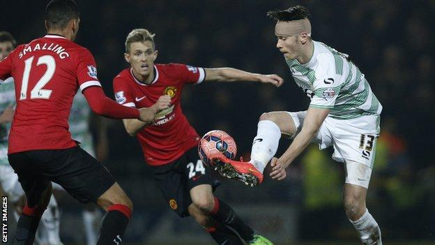 Kieffer Moore playing for Yeovil against Manchester United