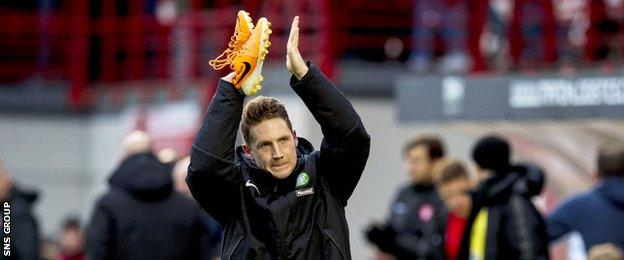 Celtic playmaker Kris Commons applauds the visiting Celtic supporters at New Douglas Park