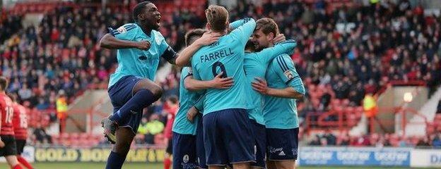 Telford players celebrate Tony Gray's second goal in the 4-0 win at Wrexham