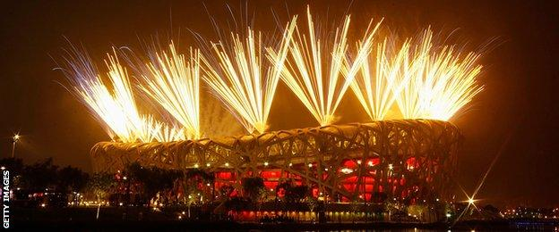 Fireworks explode during the Opening Ceremony for the 2008 Beijing Summer Olympics at the National Stadium on August 8, 2008