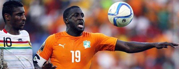 Guinea's Kevin Constant and Yaya Toure of Ivory Coast