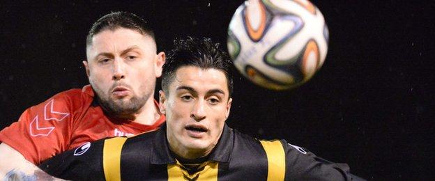 Larne's Ciaran Murray competes against Aaron Trainor of Carrick Rangers at Inver Park