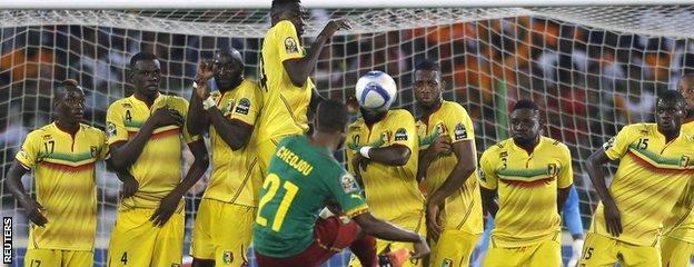 Aurelien Chedjou takes a free-kick