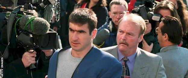 Eric Cantona arrives at East Croydon magistrates court with Ned Kelly (with moustache) alongside him
