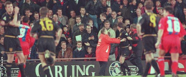 United defender Gary Pallister (far left) looks dazed as Roy Keane (16) runs towards Eric Cantona
