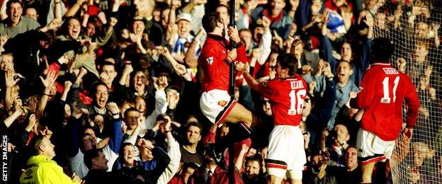 Eric Cantona celebrates scoring against Liverpool in his first game back from his ban