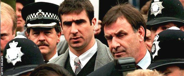 Eric Cantona arrives at Croydon Crown Court amid a throng of policemen for his appeal hearing