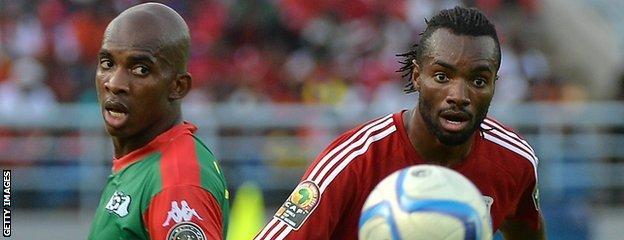 Equatorial Guinea's midfielder Javier Balboa (right) challenges Burkina Faso's midfielder Charles Kabore