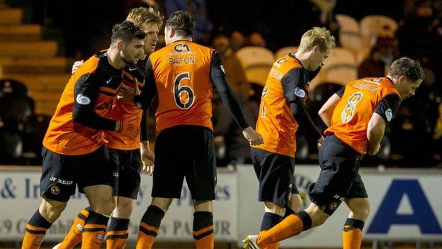 Dundee United: Stuart Armstrong celebrates with his team-mates after his equaliser