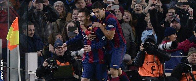 Lionel Messi and Luis Suarez celebrate