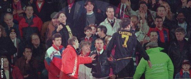 Matthew Simmons (leather jacket) taunts Eric Cantona as Palace fan Cathy Churchman (red scarf, left of Simmons), looks on