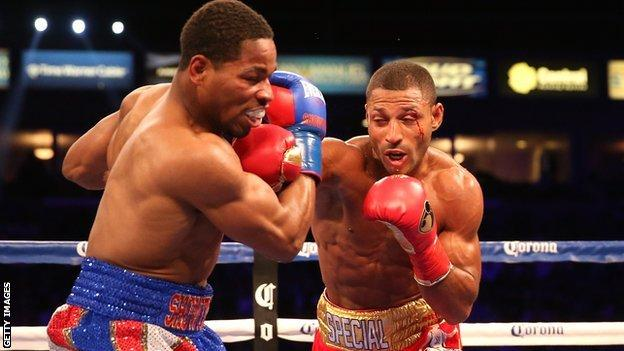 Kell Brook (right) landing a right hook on Shawn Porter in the IBF welterweight title in August 2014