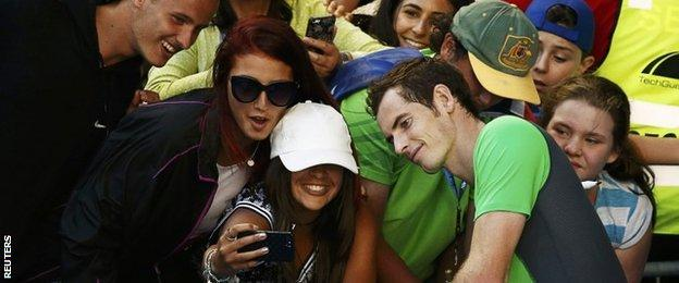 Andy Murray of Britain poses for a photograph with supporters after defeating Joao Sousa of Portugal