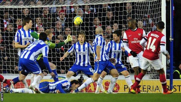 Theo Walcott scores Arsenal's winning goal as the Gunners beat Brighton 3-2 in January 2013