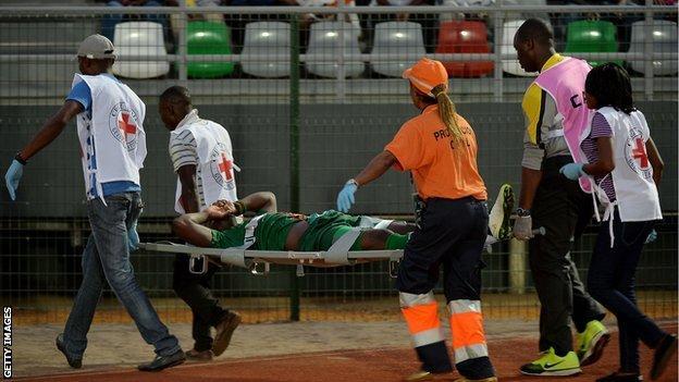 Zambia striker Emmanuel Mayuka leaves the stadium on a stretcher