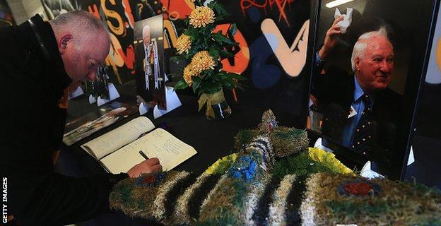 Wolves fans signing a book of condolence for former owner Sir Jack Hayward, who died earlier this month
