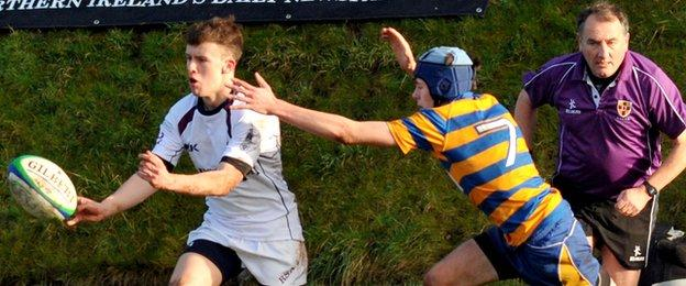 RS Armagh's Michael Murugasu is closed down by Ross Neill in the 19-10 win over Belfast High