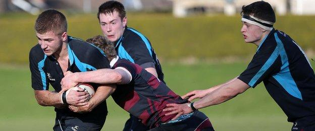 The run of Carrick GS player Tom Gilpin is halted by BRA's David McCullough in the second-round clash