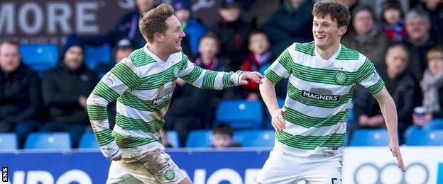 Celtic players Kris Commons and Liam Henderson celebrate