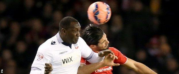 Bolton's Emile Heskey (left) and Liverpool's Emre Can