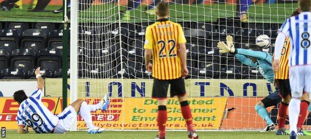 Manuel Pascali (left) knocks the ball into the net to give Kilmarnock the lead with 11 minutes left.