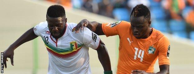 Mali's Bakary Mali's Bakary Sako (left) vies with Ivory Coast's Tiemoko Ismael Diomande