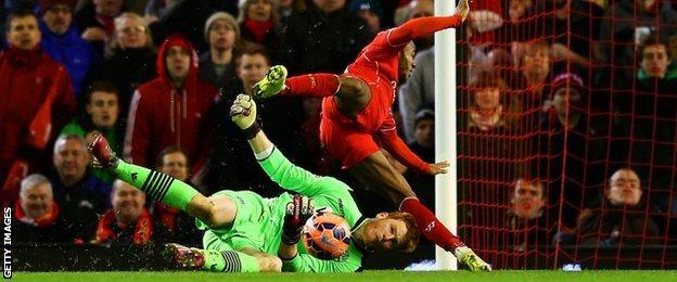 Bolton goalkeeper Adam Bogdan (bottom) and Liverpool's Raheem Sterling