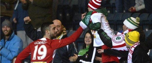Joe Gormley celebrates scoring the opener with a young Cliftonville fan