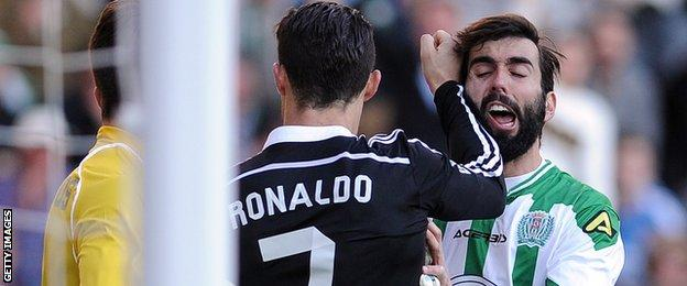 Ronaldo tussles with Jose Angel Crespo, who he appeared to punch earlier in the game